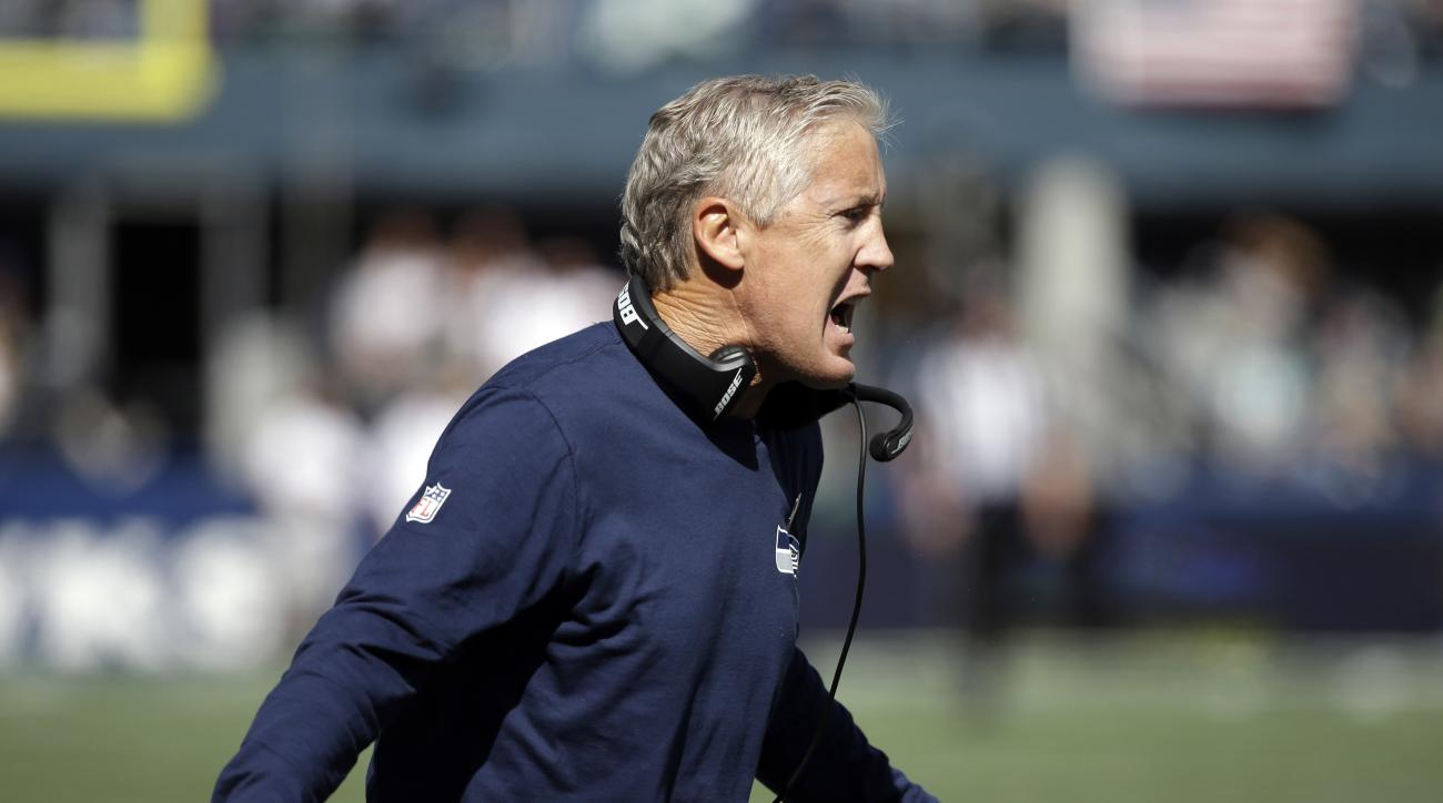 Seattle Seahawks head coach Pete Carroll calls to his team in the first half of an NFL football game against the Miami Dolphins, Sunday, Sept. 11, 2016, in Seattle. (AP Photo/Elaine Thompson)