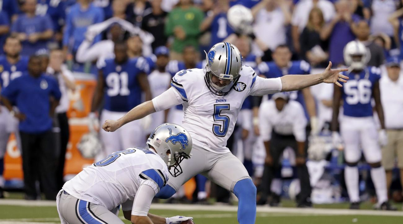 Detroit Lions kicker Matt Prater (5) kicks a game-winning field goal in the final seconds of the game from the hold of Sam Martin against the Indianapolis Colts in an NFL football game in Indianapolis, Sunday, Sept. 11, 2016. The Lions defeated the Colts