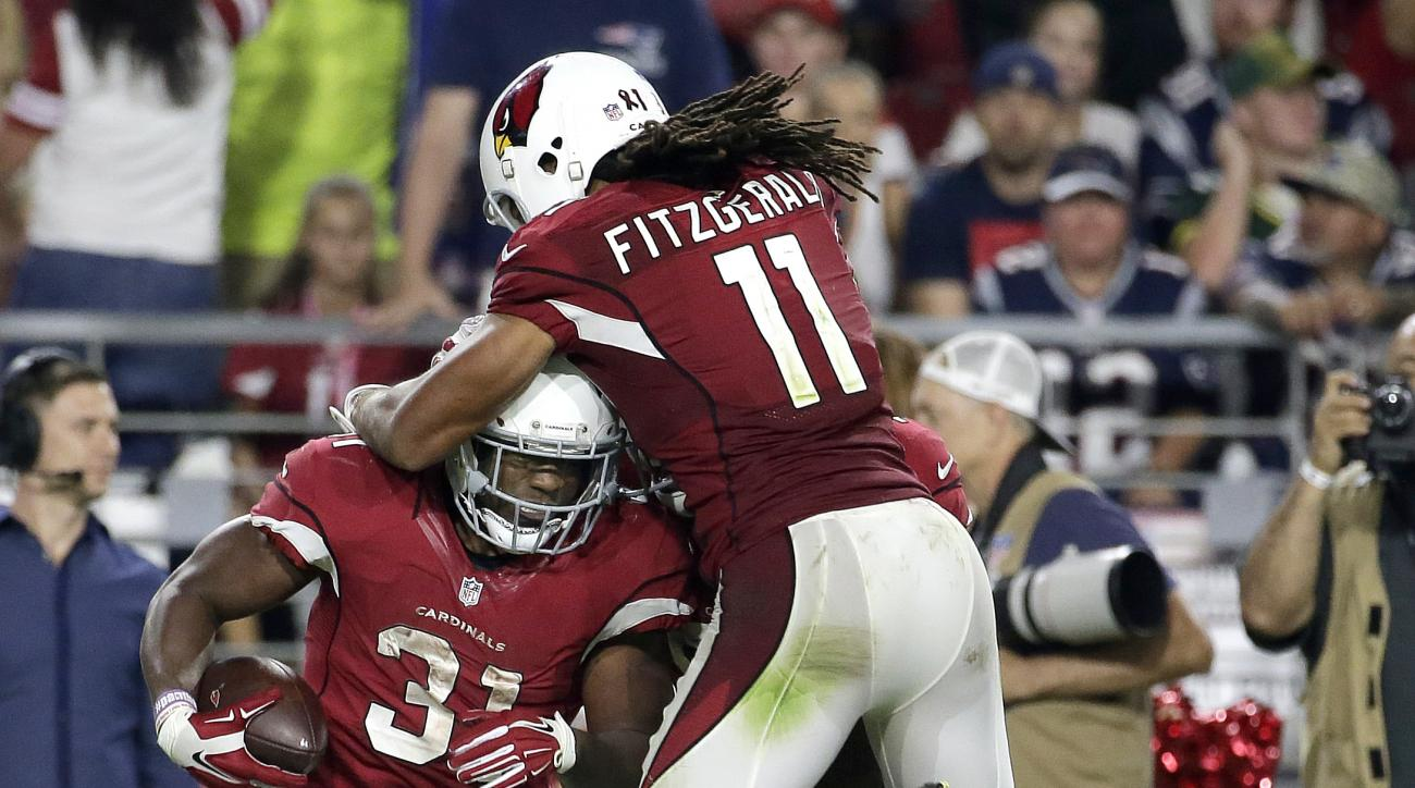 Arizona Cardinals running back David Johnson (31) celebrates his first down run with teammate Larry Fitzgerald during the second half of an NFL football game against the New England Patriots, Sunday, Sept. 11, 2016, in Glendale, Ariz. (AP Photo/Rick Scute