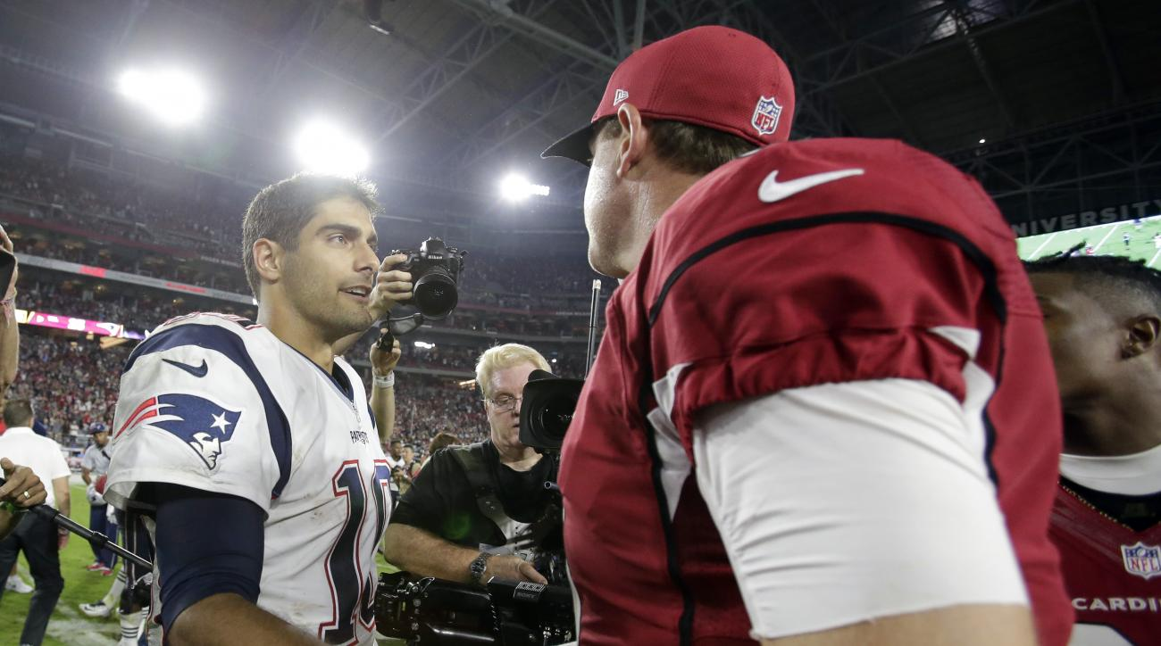 New England Patriots quarterback Jimmy Garoppolo (10) and Arizona Cardinals quarterback Carson Palmer (3) meet at mid field after an NFL football game, Sunday, Sept. 11, 2016, in Glendale, Ariz. The Patriots won 23-21. (AP Photo/Rick Scuteri)