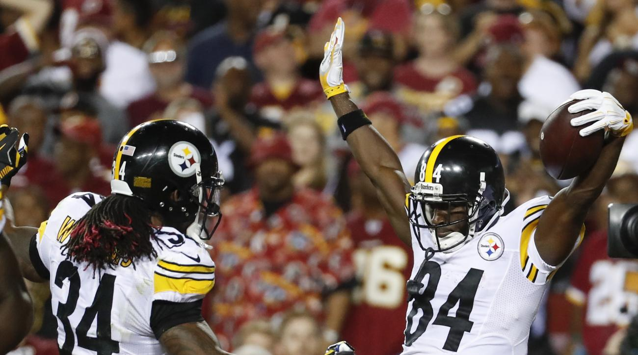 Pittsburgh Steelers wide receiver Antonio Brown (84) celebrates his touchdown with running back DeAngelo Williams (34) during the first half of an NFL football game against the Washington Redskins in Landover, Md., Monday, Sept. 12, 2016. (AP Photo/Alex B