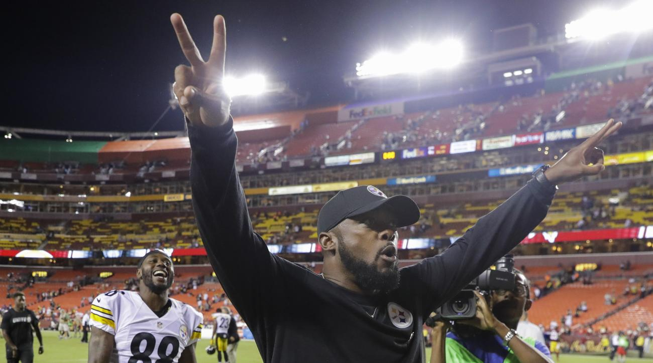 Pittsburgh Steelers head coach Mike Tomlin celebrates as he walks off the field after an NFL football game against the Washington Redskins in Landover, Md., Monday, Sept. 12, 2016. The Pittsburgh Steelers defeated the Washington Redskins 38-16. (AP Photo/