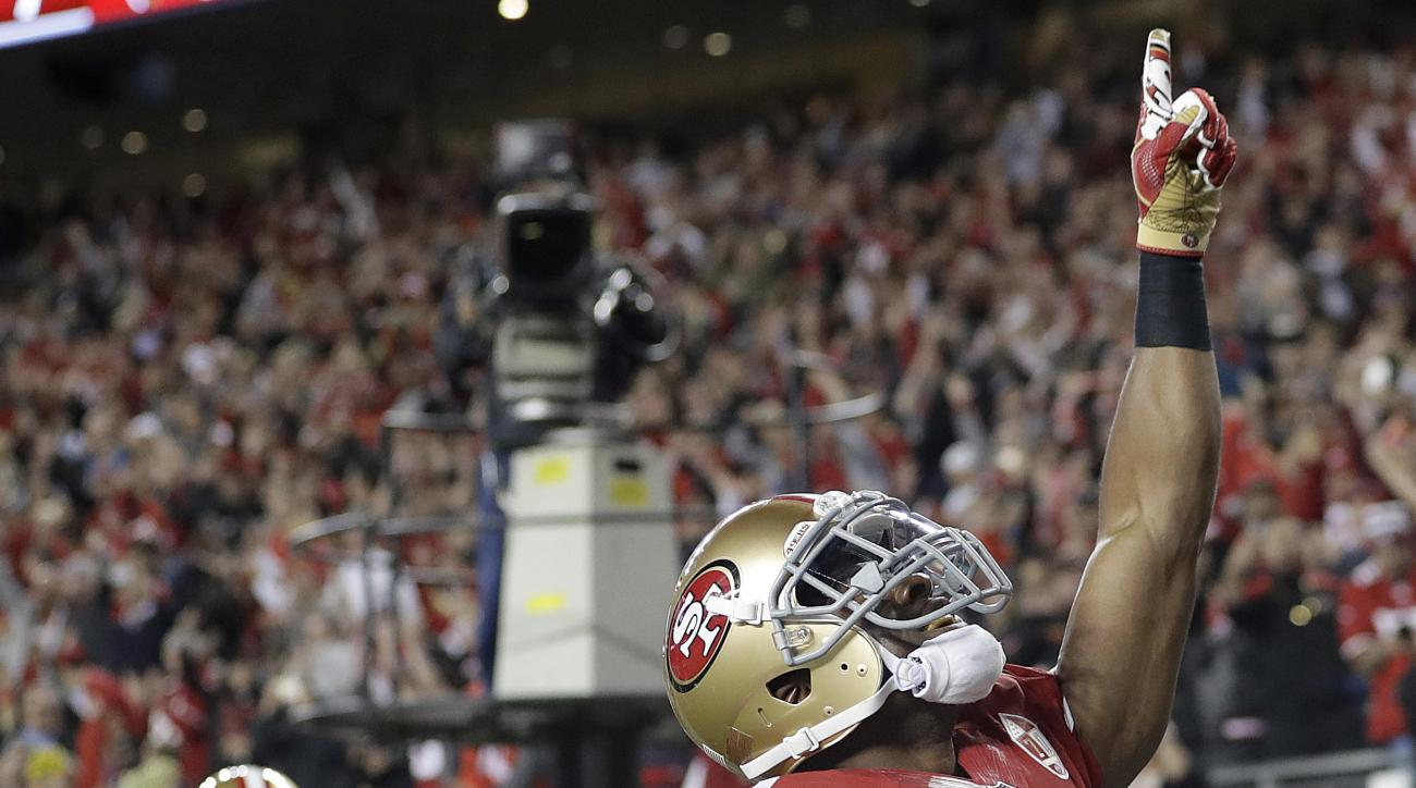 San Francisco 49ers running back Shaun Draughn (24) celebrates after running for a touchdown during the first half of an NFL football game against the Los Angeles Rams in Santa Clara, Calif., Monday, Sept. 12, 2016. (AP Photo/Marcio Jose Sanchez)