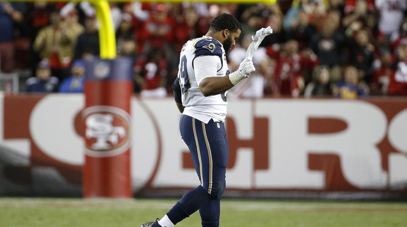 Los Angeles Rams defensive tackle Aaron Donald (99) walks off the field after being ejected during the second half of an NFL football game against the San Francisco 49ers in Santa Clara, Calif., Monday, Sept. 12, 2016. (AP Photo/Tony Avelar)