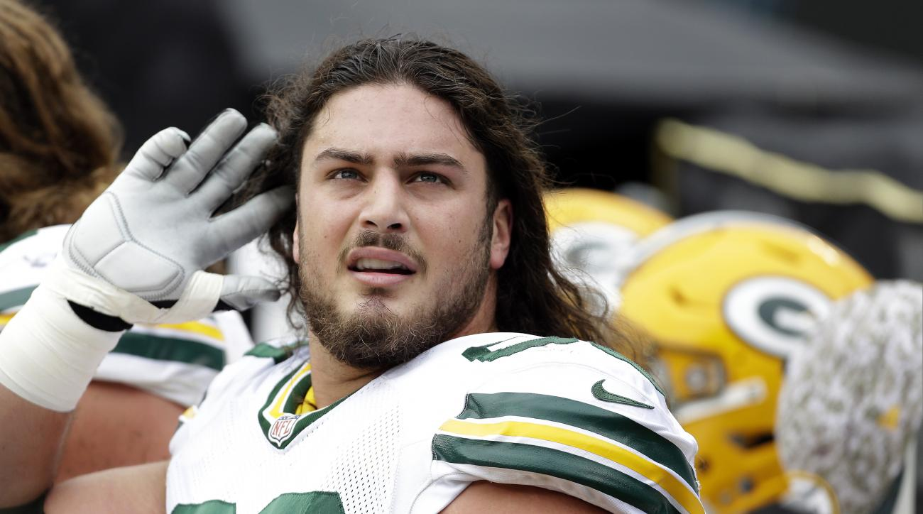 FILE - In this Nov. 8, 2015, file photo, Green Bay Packers' David Bakhtiari (69) gestures on the sidelines against the Carolina Panthers during the first half of an NFL football game in Charlotte, N.C. Packers left tackle David Bakhtiari has signed a cont