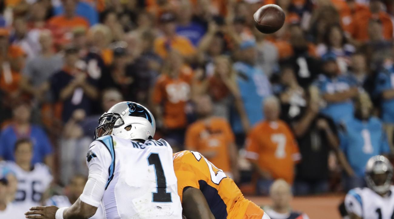 FILE - In this Sept. 8, 2016, file photo, Denver Broncos free safety Darian Stewart (26) hits Carolina Panthers quarterback Cam Newton (1) late for a penalty during the second half of an NFL football game in Denver.  As some Broncos players prepare to fac