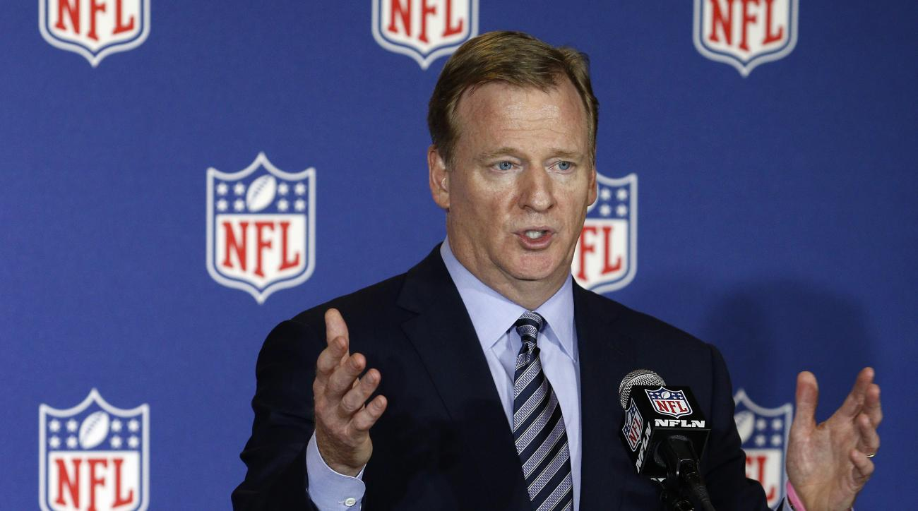 FILE - In this May 24, 2016, file photo, NFL commissioner Roger Goodell answers reporter's questions at an NFL owner's meeting in Charlotte N.C. The NFL says it will spend an additional $100 million to develop new technology and support more medical resea