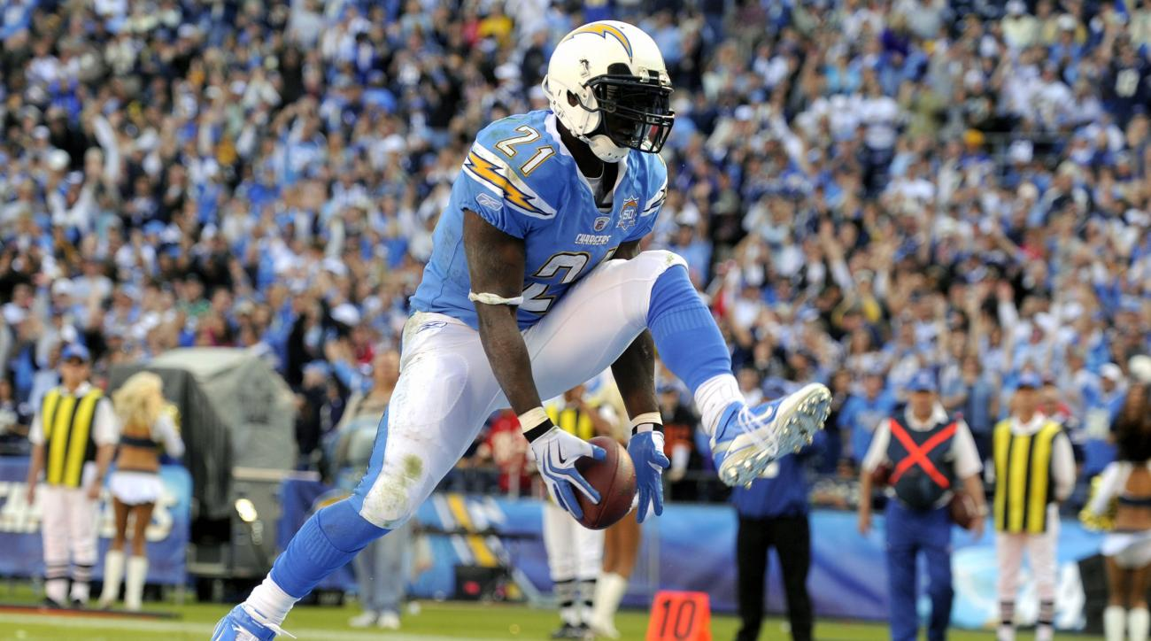 FILE - In this Nov. 29, 2009, file photo, San Diego Chargers running back LaDainian Tomlinson celebrates his second touchdown during the third quarter of an NFL football game against the Kansas City Chiefs, in San Diego, Calif. The list of Modern-Era nomi
