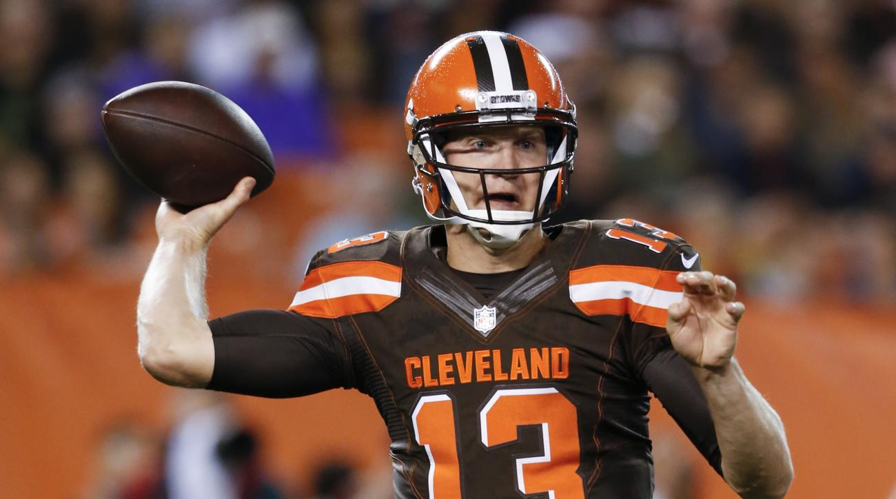 FILE - In this Sept. 1, 2016, file photo, Cleveland Browns quarterback Josh McCown throws in the first half of an NFL preseason football game against the Chicago Bears, in Cleveland. McCown spent the summer in trade rumors and Robert Griffin III's shadow.