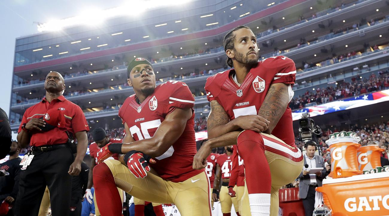 FILE - Int his Monday, Sept. 12, 2016, file photo, San Francisco 49ers safety Eric Reid (35) and quarterback Colin Kaepernick (7) kneel during the national anthem before an NFL football game against the Los Angeles Rams in Santa Clara, Calif. The dozen NF