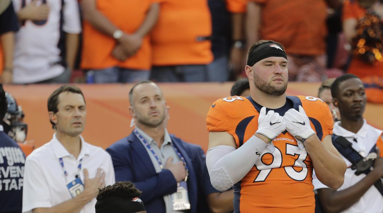 FILE - In this Thursday, Sept. 8, 2016, file photo, Denver Broncos inside linebacker Brandon Marshall (54) kneels on the sideline during the national anthem before an NFL football game against the Carolina Panthers in Denver. The dozen NFL players who hav