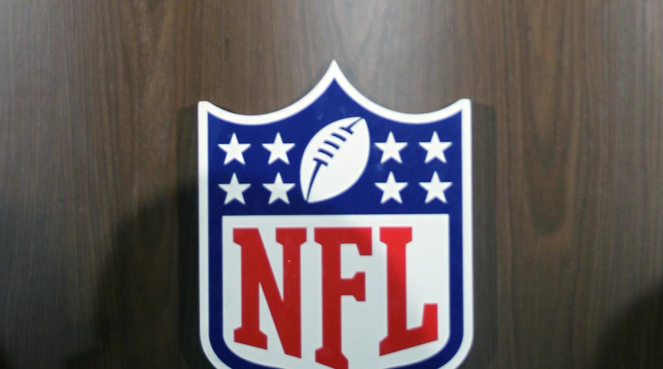 FILE - In this March 23, 2016 file photo, the NFL logo is seen on a podium during a news conference at the NFL owners meeting in Boca Raton, Fla. House Republicans are calling for an independent review of allegations the National Football League sought to