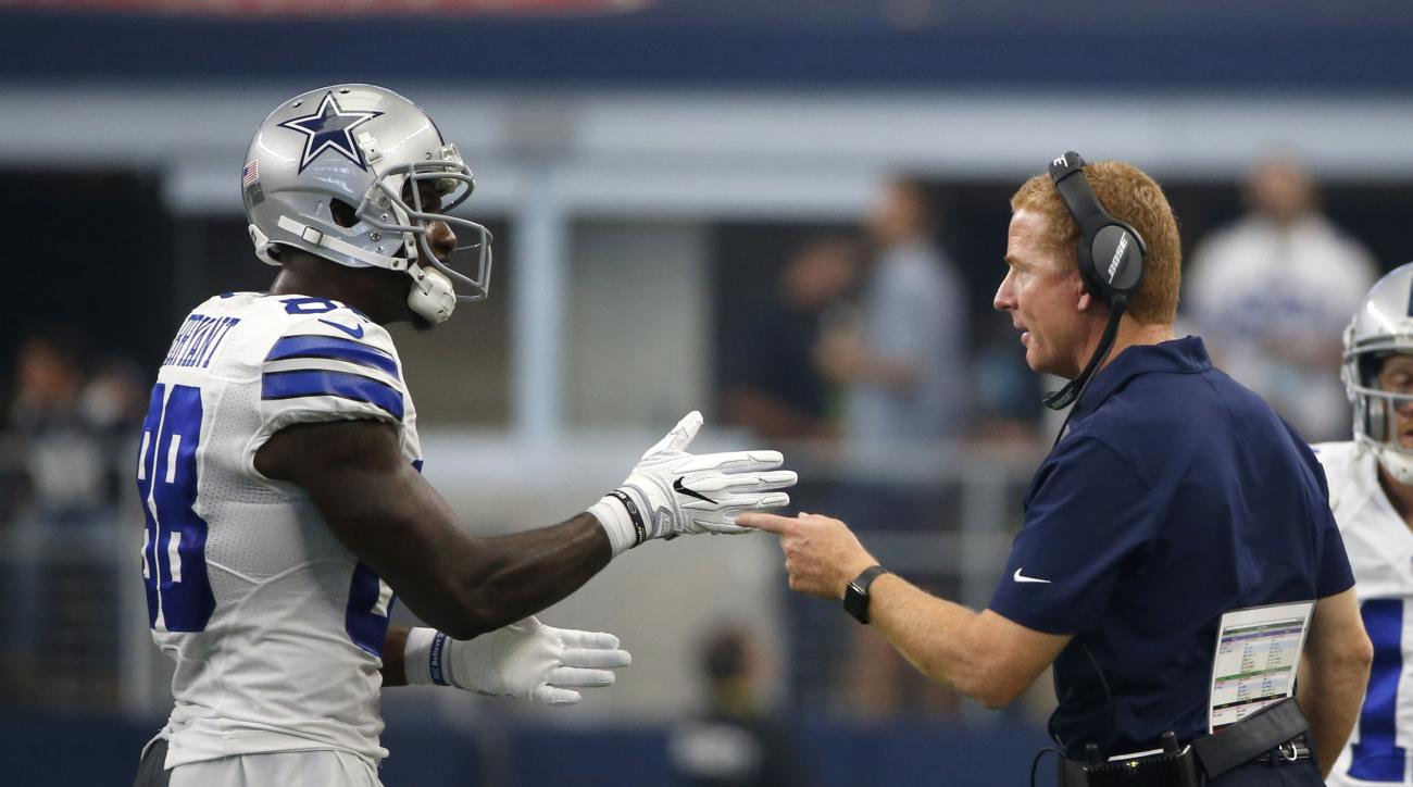 FILE- In this Sunday, Sept. 11, 2016, file photo,  Dallas Cowboys wide receiver Dez Bryant (88) and head coach Jason Garret, right, talk during the first half of an NFL football game against the New York Giants in  Arlington, Texas.   few years ago, Bryan