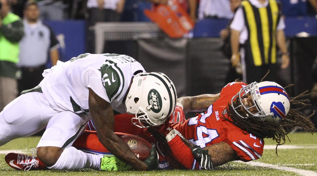 New York Jets wide receiver Brandon Marshall (15) is injured while being tackled by Buffalo Bills cornerback Stephon Gilmore (24) during the first half an NFL football game on Thursday, Sept. 15, 2016, in Orchard Park, N.Y. (AP Photo/Bill Wippert)