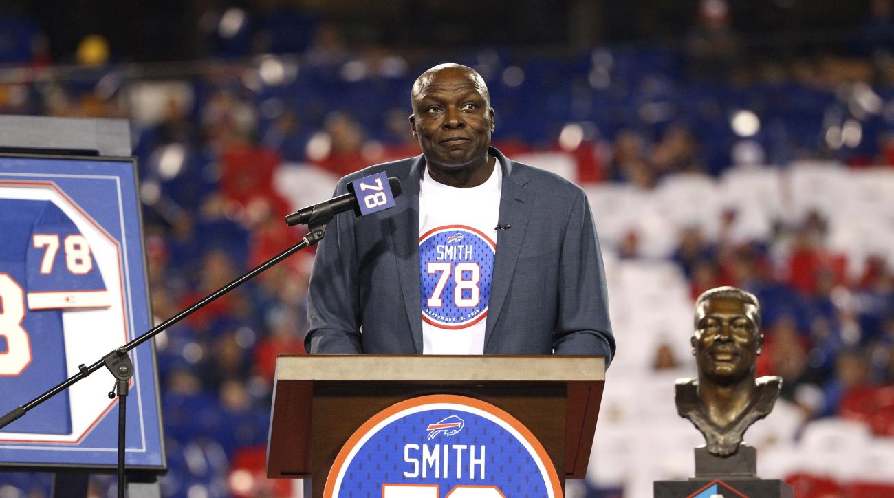 Hall of Famer Bruce Smith, a former Buffalo Bill, speaks after his jersey number was retired during halftime an NFL football game between the  Bills and the New York Jets on Thursday, Sept. 15, 2016, in Orchard Park, N.Y. (AP Photo/Bill Wippert)