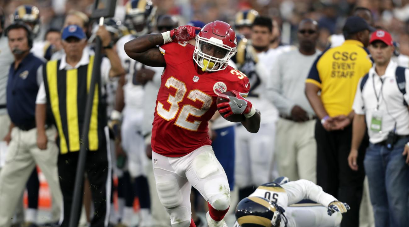 FILE - In this Aug. 20, 2016, file Photo, Kansas City Chiefs running back Spencer Ware runs the ball during the first half of a preseason NFL football game against the Los Angeles Rams in Los Angeles. Ware powered Kansas City's running game last week. (AP