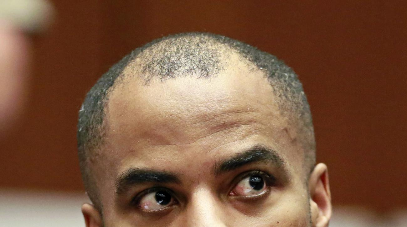 FILE - In this March 23, 2015, file photo, former NFL football player Darren Sharper appears in Los Angeles Superior Court. A Nevada judge refused to dismiss a civil lawsuit by a woman seeking hundreds of thousands of dollars from Sharper for allegedly dr