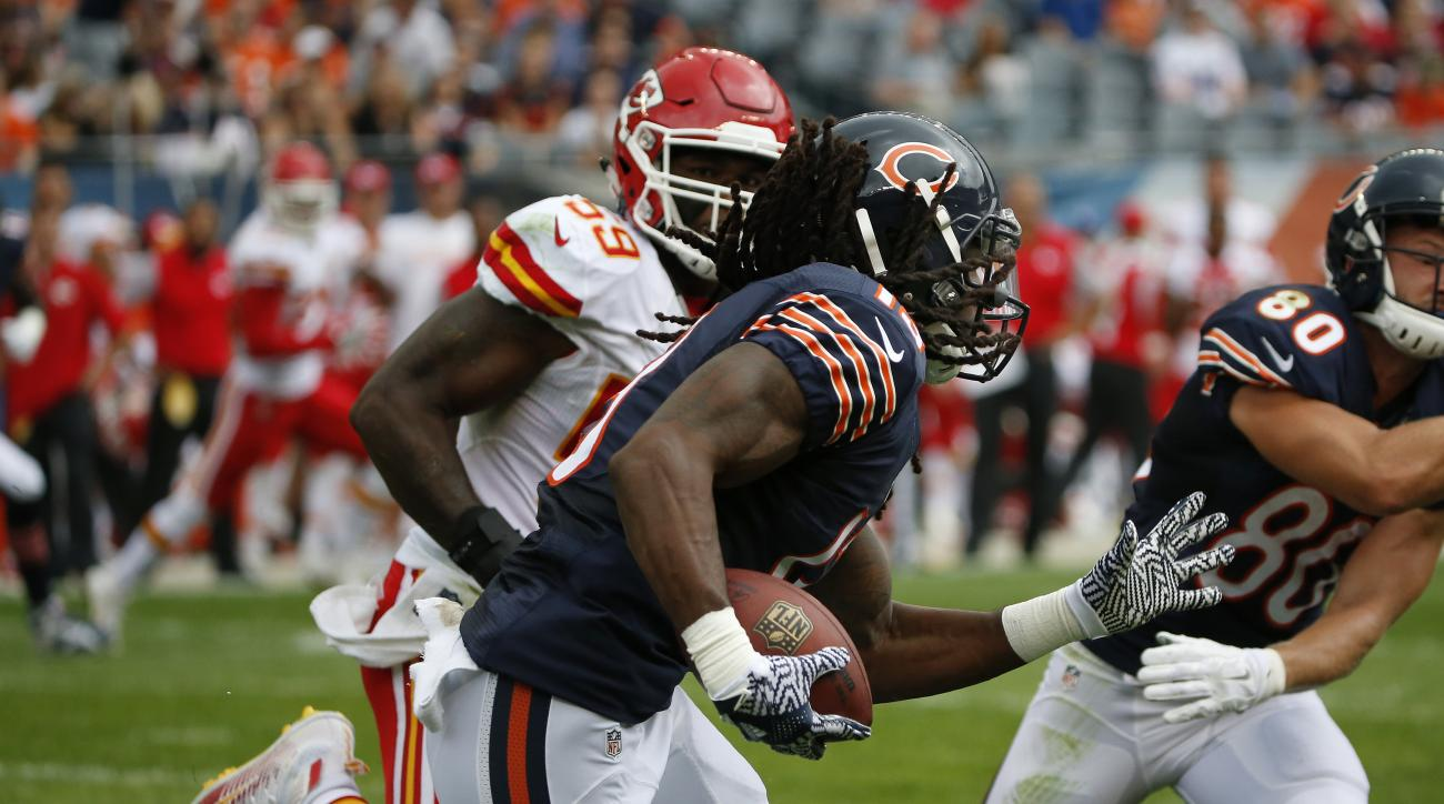 FILE - In this Aug. 27, 2016, file photo, Chicago Bears wide receiver Kevin White (13) runs against Kansas City Chiefs linebacker Justin March (59) after receiving a pass during the first half of an NFL preseason football game in Chicago. The Bears are co
