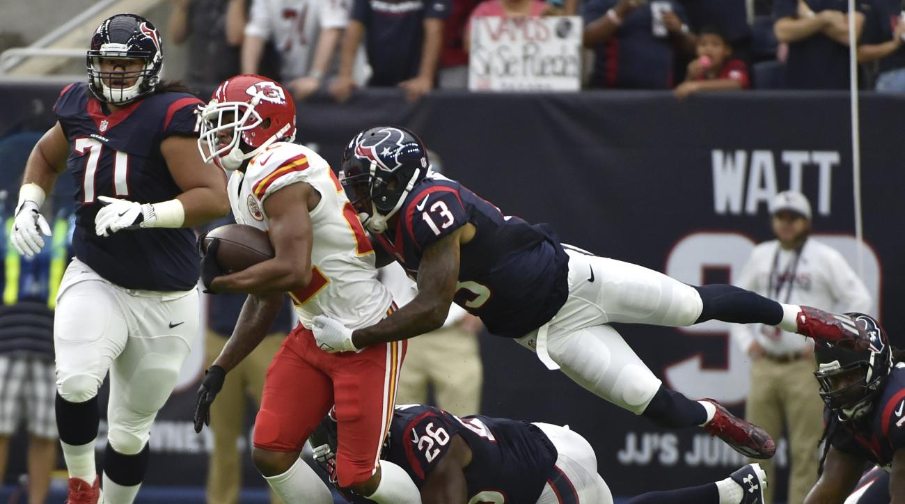 Kansas City Chiefs cornerback Marcus Peters (22) is hit by Houston Texans wide receiver Braxton Miller (13) after his goal line interception during the first half of an NFL football game Sunday, Sept. 18, 2016, in Houston. (AP Photo/Eric Christian Smith)