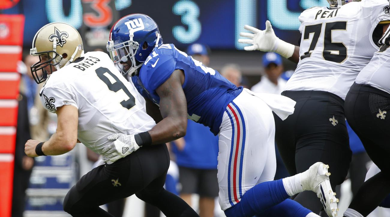 New York Giants' Landon Collins (21) sacks New Orleans Saints' Drew Brees (9) during the first half of an NFL football game Sunday, Sept. 18, 2016, in East Rutherford, N.J. (AP Photo/Kathy Willens)