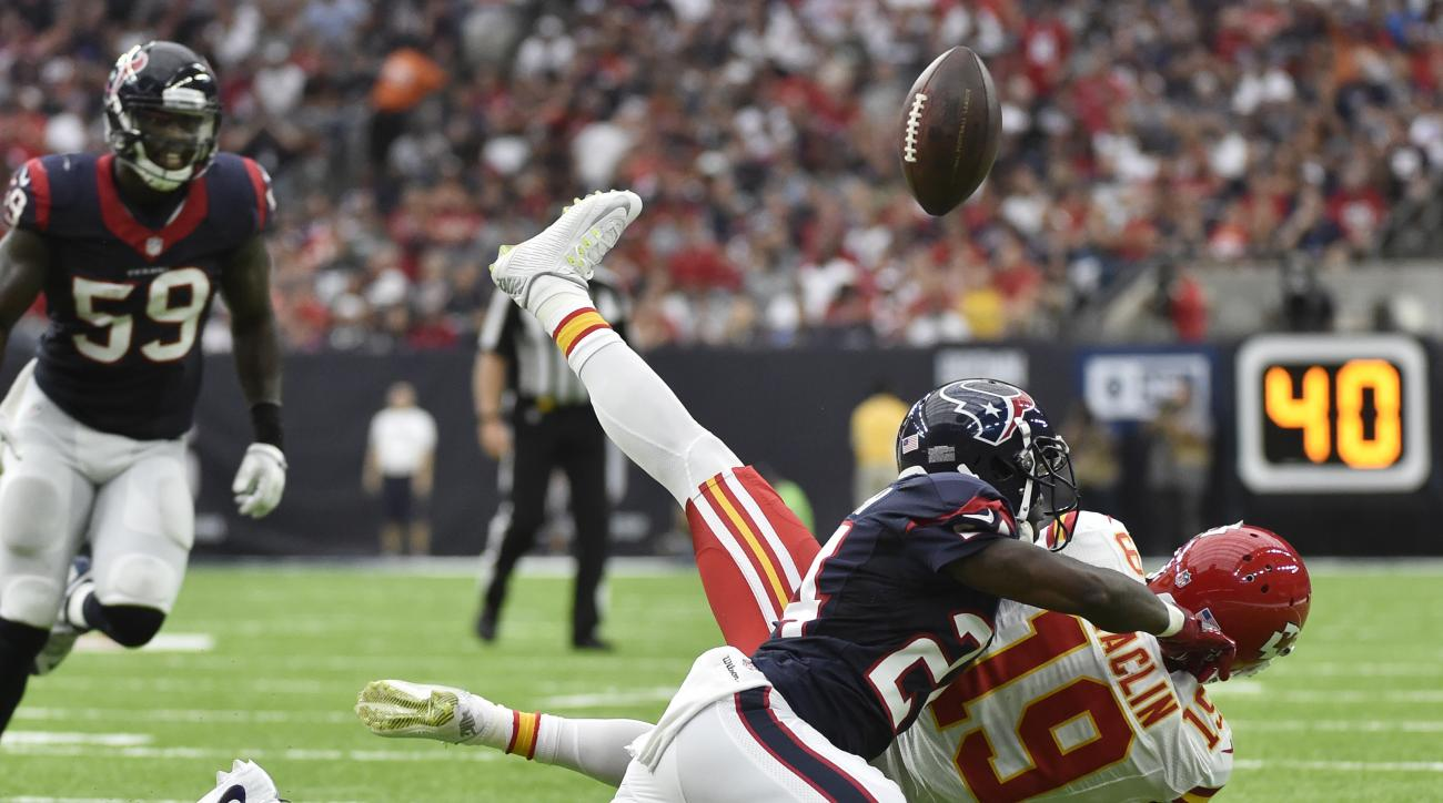Houston Texans cornerback Johnathan Joseph (24) breaks up a pass intended for Kansas City Chiefs wide receiver Jeremy Maclin (19) during the first half of an NFL football game Sunday, Sept. 18, 2016, in Houston. (AP Photo/Eric Christian Smith)