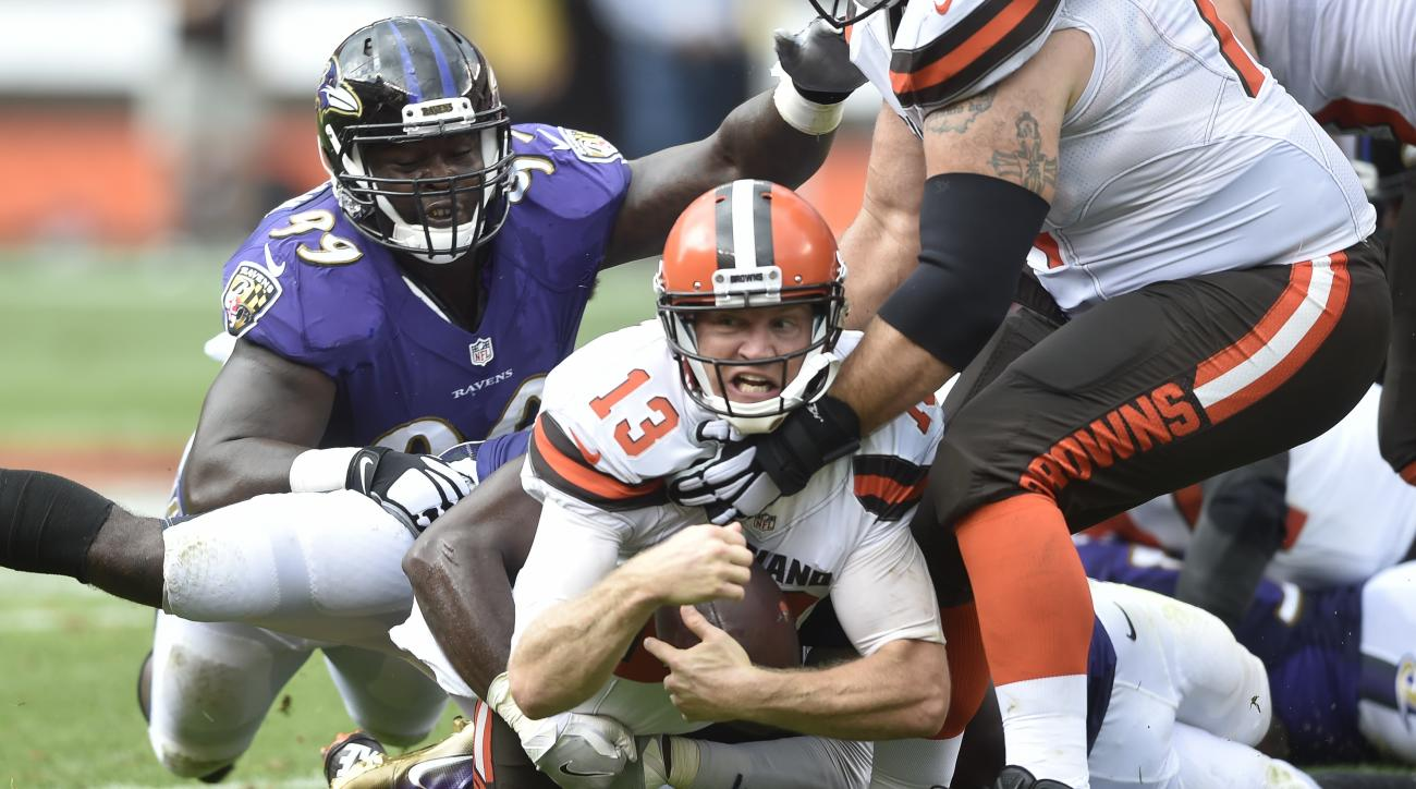 Cleveland Browns quarterback Josh McCown (13) reacts as he is tackled by Baltimore Ravens inside linebacker Zach Orr, obscured, in the first half of an NFL football game, Sunday, Sept. 18, 2016, in Cleveland. (AP Photo/David Richard)