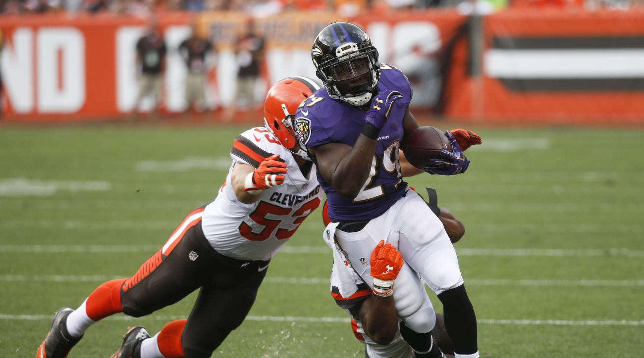 Baltimore Ravens running back Justin Forsett (29) is tackled by Cleveland Browns strong safety Ibraheim Campbell, behind, and outside linebacker Joe Schobert (53) in the first half of an NFL football game, Sunday, Sept. 18, 2016, in Cleveland. (AP Photo/R