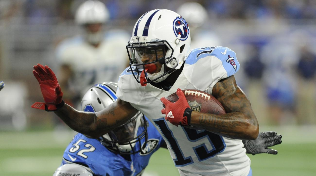Tennessee Titans wide receiver Tajae Sharpe (19) outruns Detroit Lions linebacker Antwione Williams (52) during the first half of an NFL football game, Sunday, Sept. 18, 2016, in Detroit. (AP Photo/Jose Juarez)