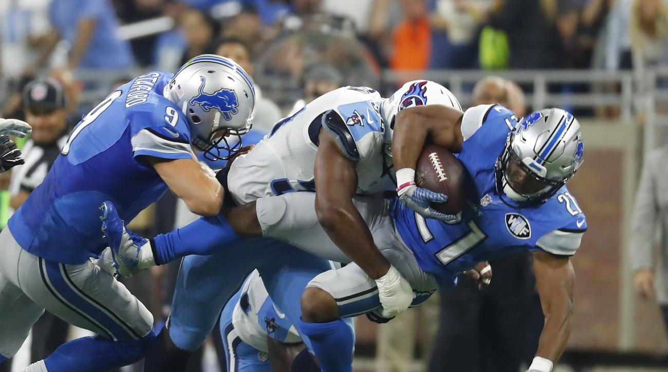 Detroit Lions running back Ameer Abdullah (21) is tackled by Tennessee Titans inside linebacker Avery Williamson during the first half of an NFL football game, Sunday, Sept. 18, 2016, in Detroit. (AP Photo/Paul Sancya)