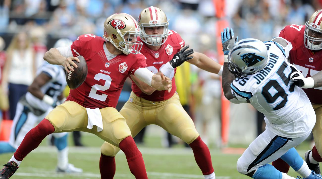 San Francisco 49ers' Blaine Gabbert (2) tries to avoid the rush of Carolina Panthers' Charles Johnson (95) in the first half of an NFL football game in Charlotte, N.C., Sunday, Sept. 18, 2016. (AP Photo/Mike McCarn)