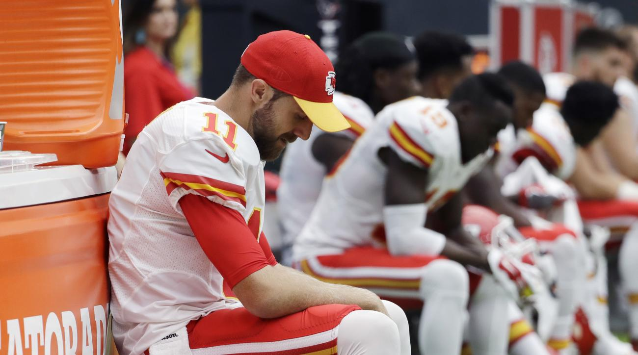 Kansas City Chiefs quarterback Alex Smith (11) sits on the sideline during the second half of an NFL football game against the Houston Texans, Sunday, Sept. 18, 2016, in Houston. (AP Photo/David J. Phillip)