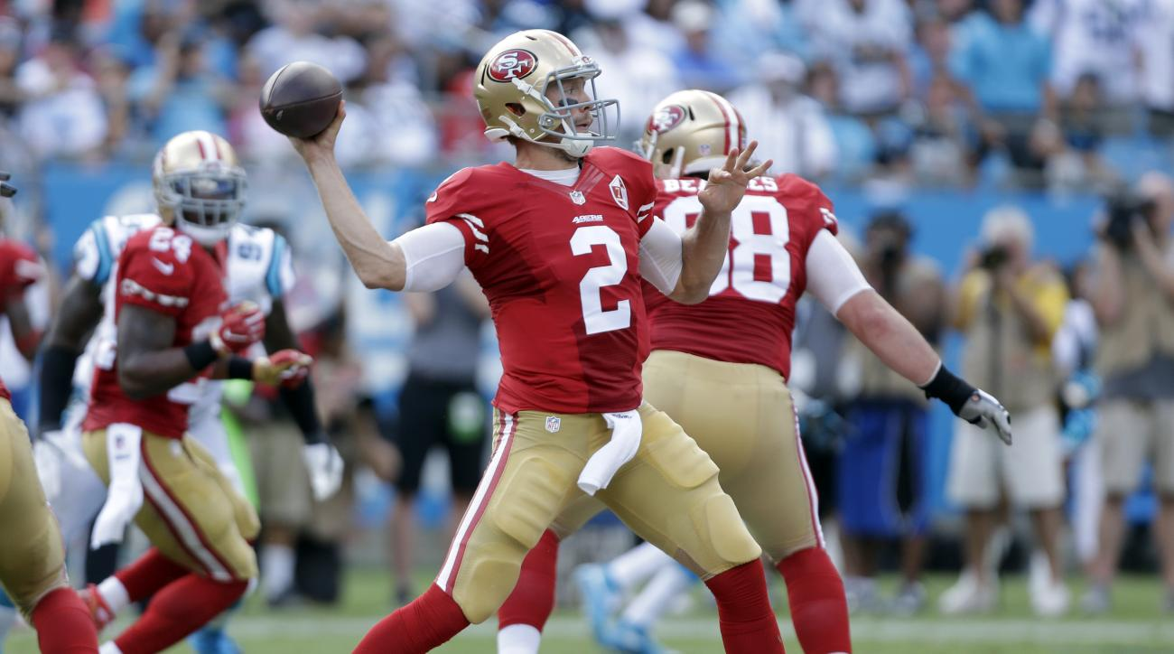 San Francisco 49ers' Blaine Gabbert (2) looks to pass against the Carolina Panthers in the second half of an NFL football game in Charlotte, N.C., Sunday, Sept. 18, 2016. (AP Photo/Bob Leverone)