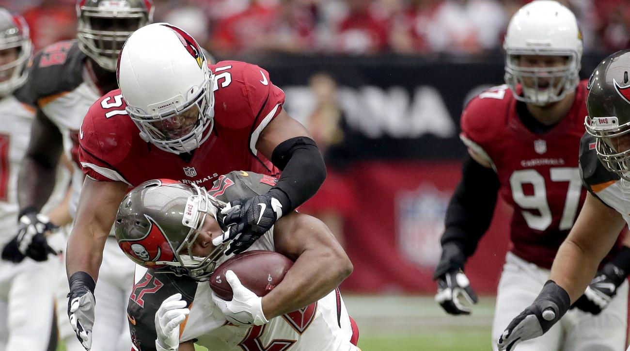 Tampa Bay Buccaneers running back Doug Martin (22) is hit by Arizona Cardinals safety Tyrann Mathieu (32) and linebacker Kevin Minter (51) during the first half of an NFL football game, Sunday, Sept. 18, 2016, in Glendale, Ariz. (AP Photo/Rick Scuteri)
