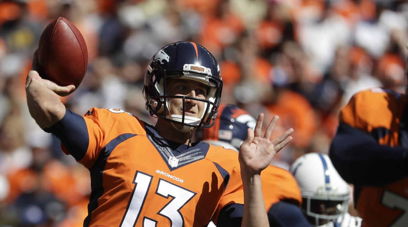 Denver Broncos quarterback Trevor Siemian passes against the Indianapolis Colts during the first half in a NFL football game, Sunday, Sept. 18, 2016, in Denver. (AP Photo/Jack Dempsey)