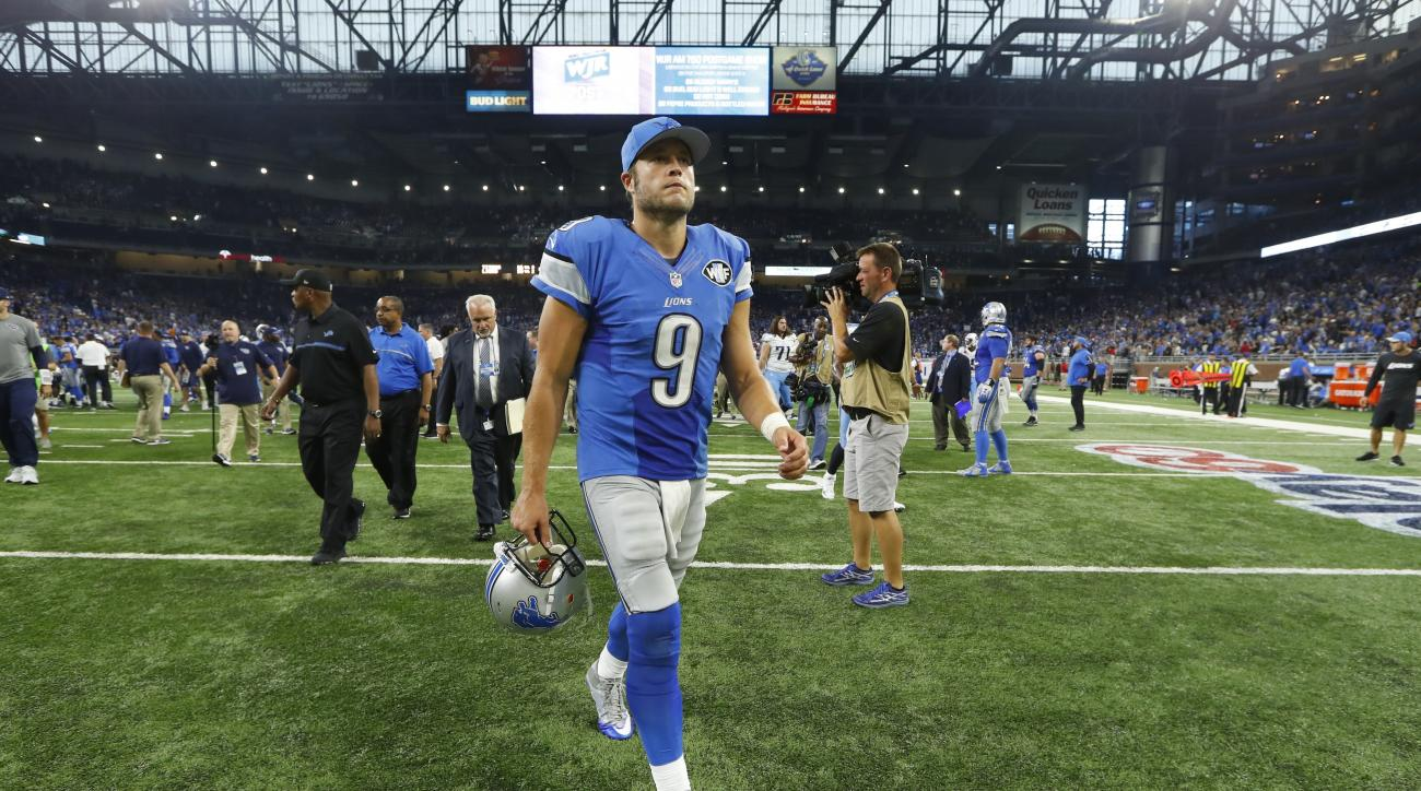 Detroit Lions quarterback Matthew Stafford walks off the field after an NFL football game against the Tennessee Titans, Sunday, Sept. 18, 2016, in Detroit. The Titans defeated the Lions 16-15. (AP Photo/Paul Sancya)