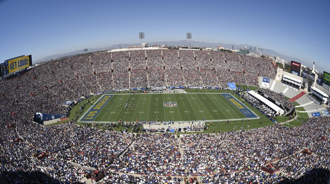 The Los Angeles Memorial Coliseum is seen with downtown Los Angeles, at right, during the first half an NFL football game between the Los Angeles Rams and the Seattle Seahawks, Sunday, Sept. 18, 2016, in Los Angeles. (AP Photo/Kelvin Kuo)