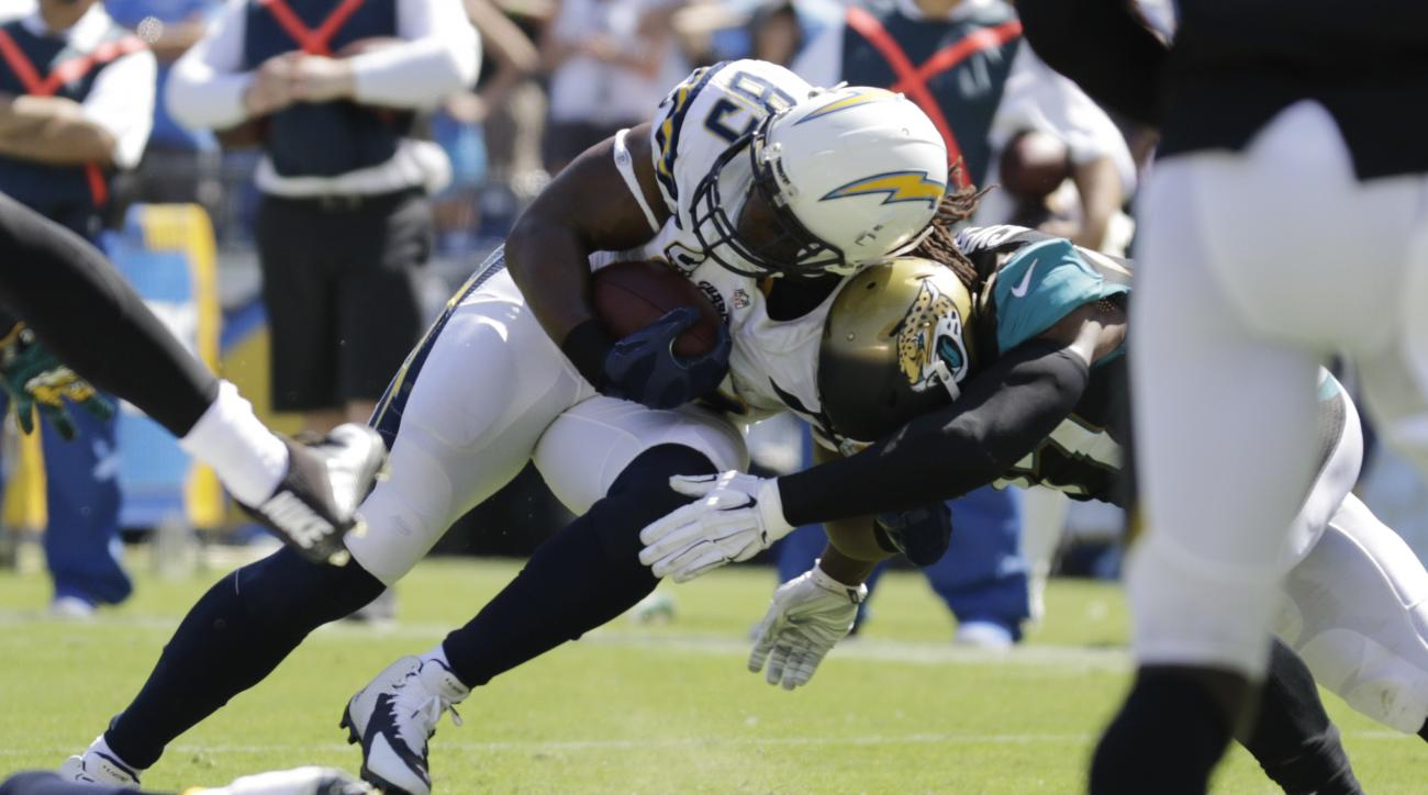 San Diego Chargers tight end Antonio Gates scores a touchdown as Jacksonville Jaguars strong safety Johnathan Cyprien defends during the first half of an NFL football game, Sunday, Sept. 18, 2016, in San Diego. (AP Photo/Ryan Kang)