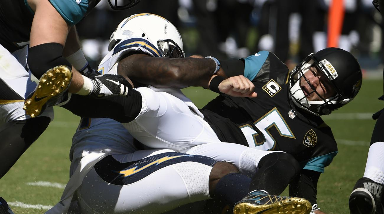 Jacksonville Jaguars quarterback Blake Bortles (5) loses the ball as he is brought down by San Diego Chargers defensive end Corey Liuget during the first half of an NFL football game Sunday, Sept. 18, 2016, in San Diego. The Chargers recovered the ball on