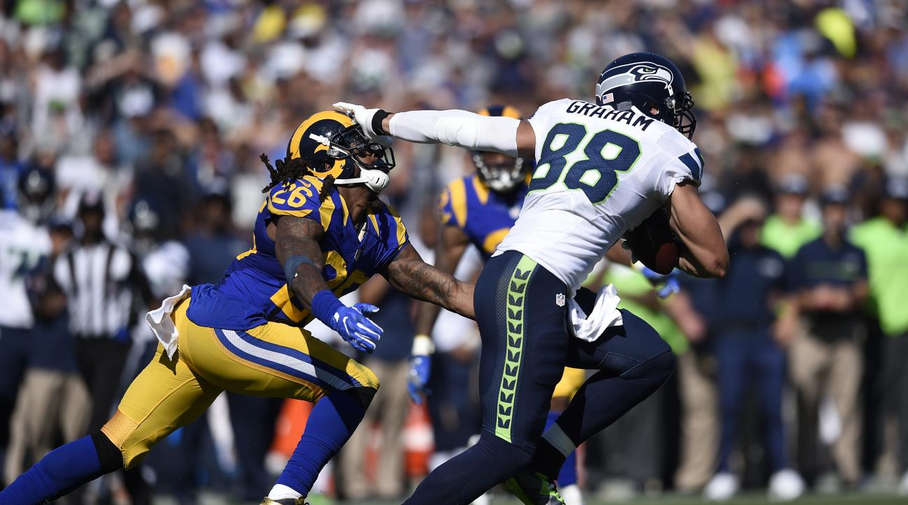 Seattle Seahawks tight end Jimmy Graham, right, fends off Los Angeles Rams outside linebacker Mark Barron during the second half of an NFL football game at the Los Angeles Memorial Coliseum, Sunday, Sept. 18, 2016, in Los Angeles. (AP Photo/Kelvin Kuo)