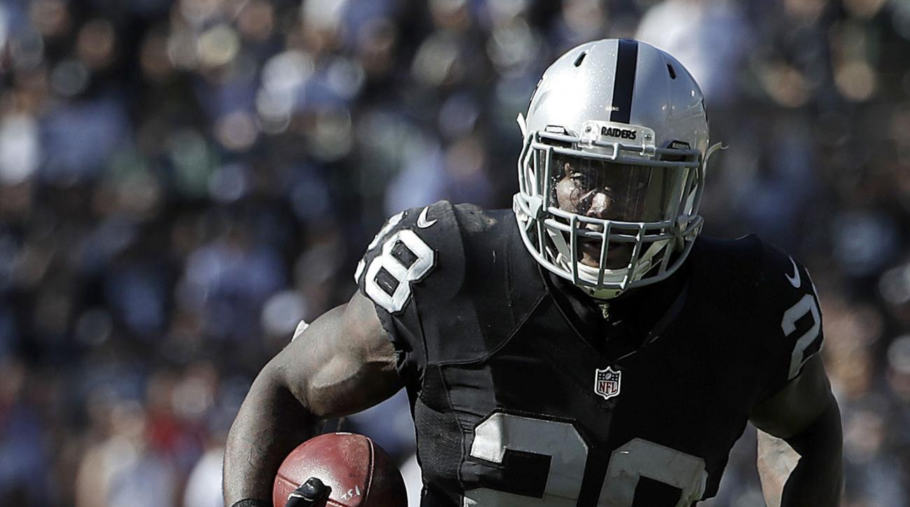 Oakland Raiders running back Latavius Murray (28) runs in front of Atlanta Falcons outside linebacker Philip Wheeler (41) during the second half of an NFL football game in Oakland, Calif., Sunday, Sept. 18, 2016. (AP Photo/Marcio Jose Sanchez)