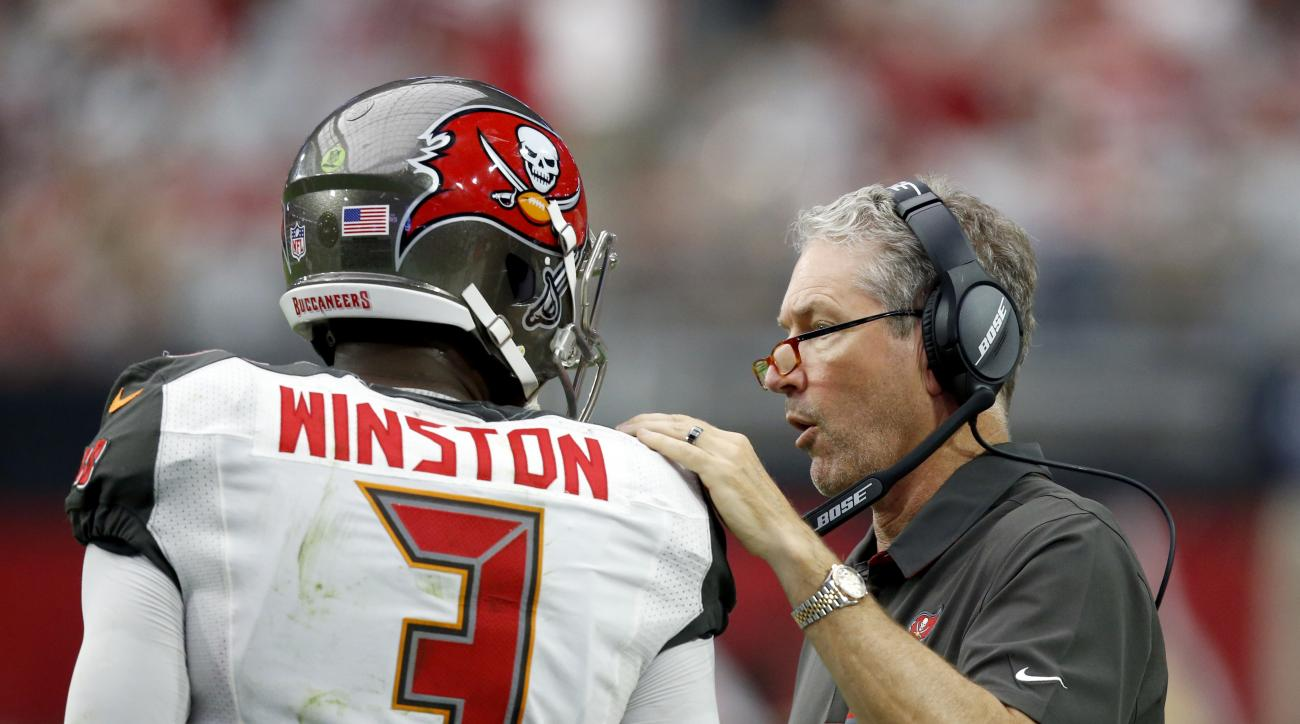 Tampa Bay Buccaneers head coach Dirk Koetter talks with quarterback Jameis Winston (3) during the second half of an NFL football game against the Arizona Cardinals, Sunday, Sept. 18, 2016, in Glendale, Ariz. (AP Photo/Ross D. Franklin)
