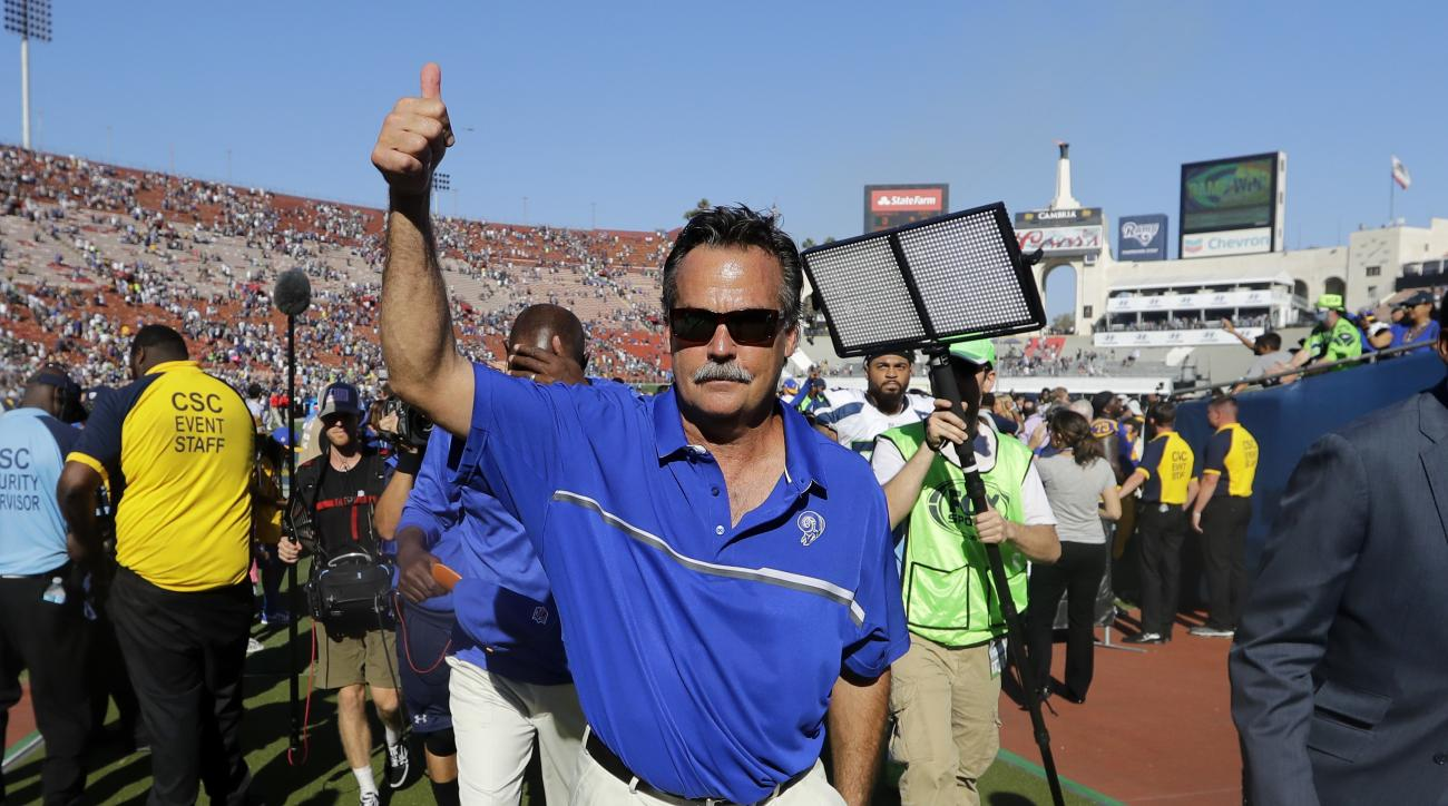 Los Angeles Rams head coach Jeff Fisher gestures after the Rams defeated the Seattle Seahawks in an NFL football game at Los Angeles Memorial Coliseum, Sunday, Sept. 18, 2016, in Los Angeles. (AP Photo/Jae Hong)