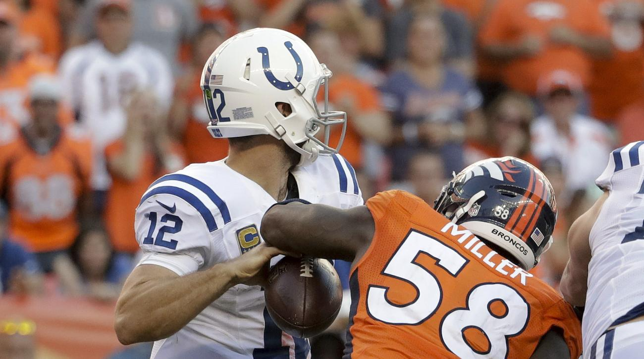 Denver Broncos outside linebacker Von Miller, right, forces a fumble by Indianapolis Colts quarterback Andrew Luck during the second half in an NFL football game, Sunday, Sept. 18, 2016, in Denver. (AP Photo/Jack Dempsey)