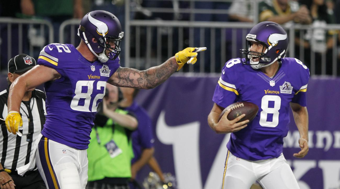 Minnesota Vikings tight end Kyle Rudolph, left, celebrates with quarterback Sam Bradford after catching an 8-yard touchdown pass during the first half of an NFL football game against the Green Bay Packers, Sunday, Sept. 18, 2016, in Minneapolis. (AP Photo