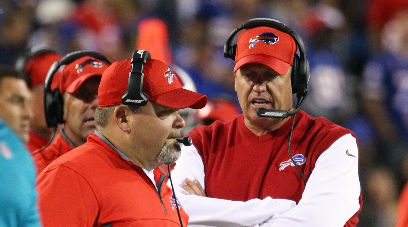 FILE - In this Thursday, Sept. 15, 2016, file photo, Buffalo Bills offensive coordinator Greg Roman, left, and head coach Rex Ryan, right, work the sidelines during the first half of an NFL football game against the New York Jets in Orchard Park, N.Y. Buf