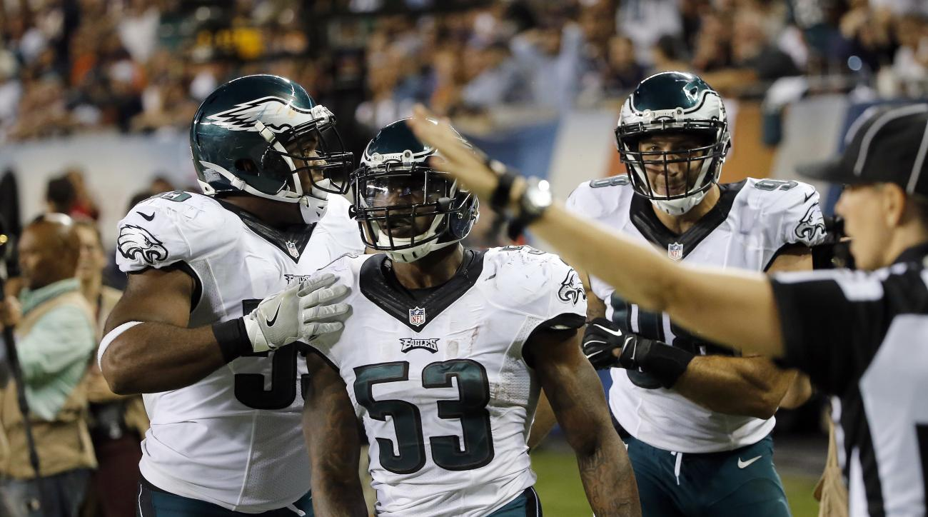 CORRECTS TO CLARIFY THERE WAS NO TOUCHDOWN ON THE PLAY - Philadelphia Eagles linebacker Nigel Bradham (53) gets celebrated after intercepting a pass during the second half of an NFL football game against the Chicago Bears, Monday, Sept. 19, 2016, in Chica