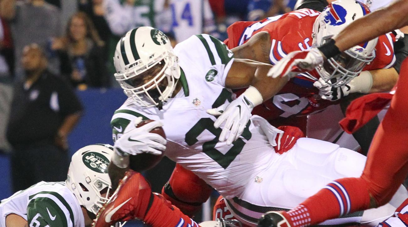 FILE - In this Sept. 16, 2016, file photo, New York Jets running back Matt Forte (22) dives for a touchdown during the first half an NFL football game against the Buffalo Bills, in Orchard Park, N.Y. The 30-year-old running back looks rejuvenated, and att