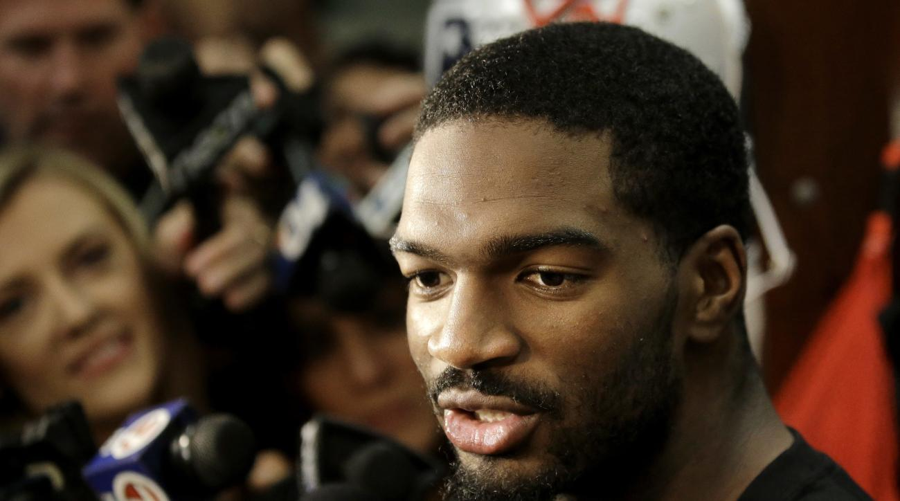 New England Patriots quarterback Jacoby Brissett speaks with members of the media in the team's locker room following NFL football team practice Tuesday, Sept. 20, 2016, in Foxborough, Mass. (AP Photo/Steven Senne)