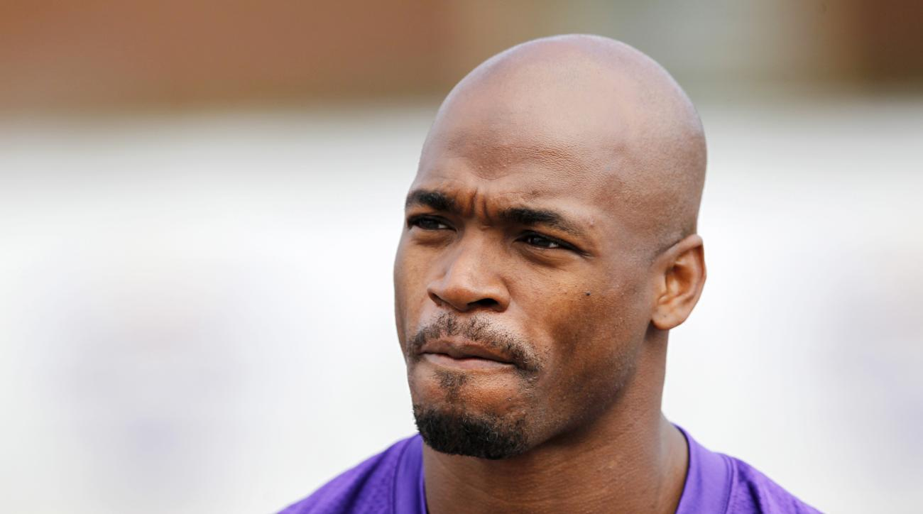 FILE - In this July 29, 2016, file photo, Minnesota Vikings running back Adrian Peterson is shown during the first day of the NFL teams training camp at Mankato State University in Mankato, Minn. Peterson will undergo surgery on his right knee to repair a