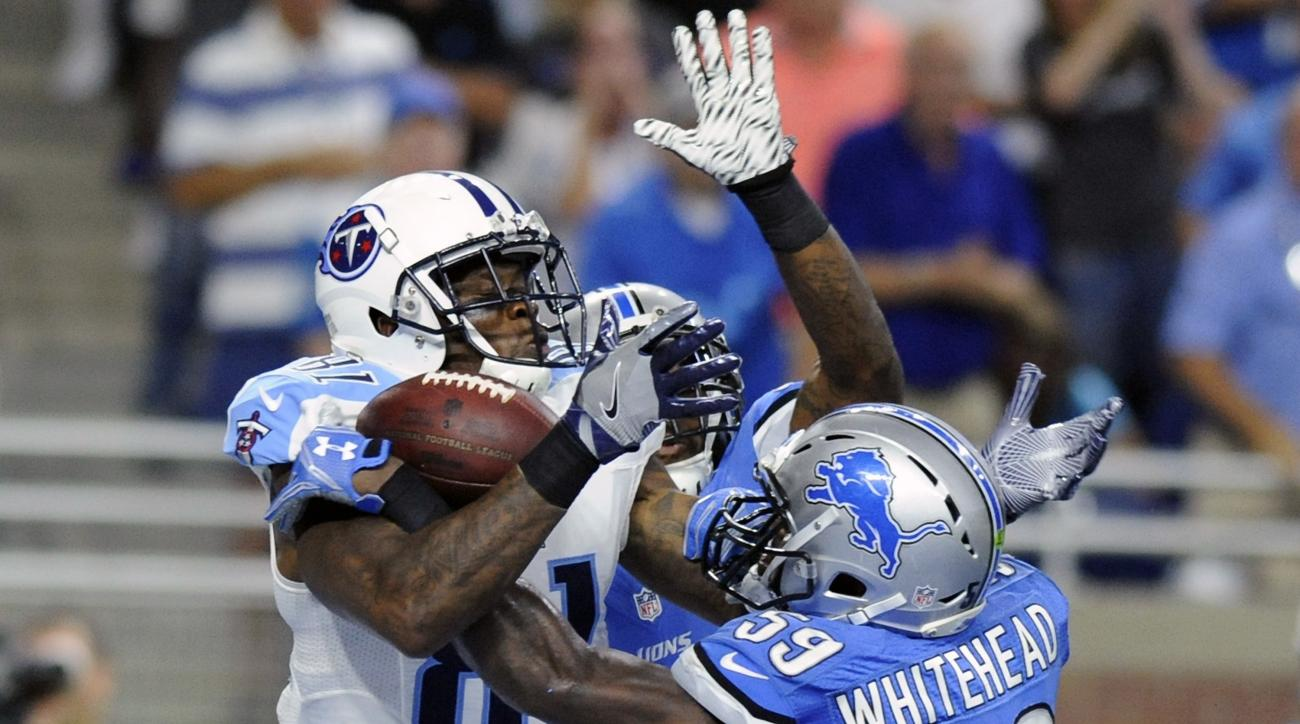 FILE - In this Sept. 18, 2016, file photo, Tennessee Titans wide receiver Andre Johnson (81), defended by Detroit Lions middle linebacker Tahir Whitehead (59), catches a 9-yard pass for a touchdown during the second half of an NFL football game, in Detroi